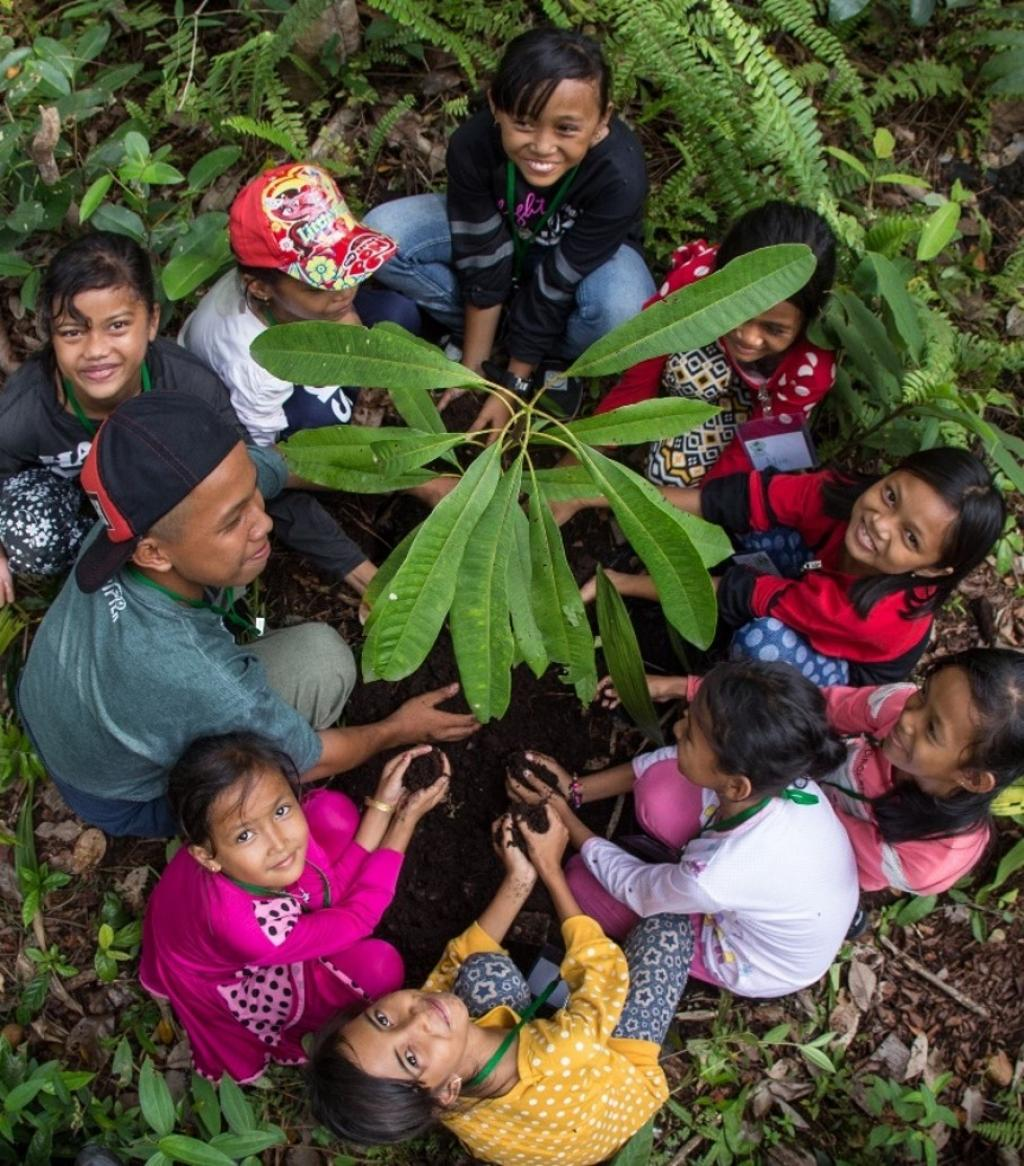 Local children assisting with tree planting activities