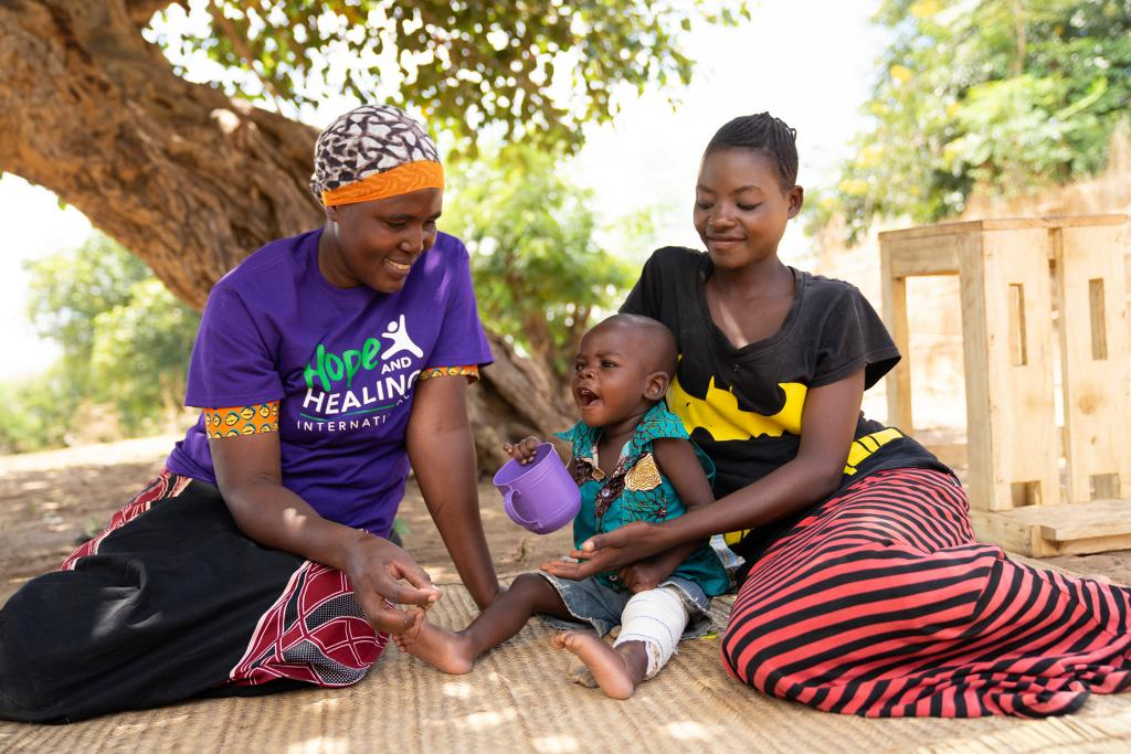 A community worker visits a mother who's child lives with cerebral palsy to provide essential care