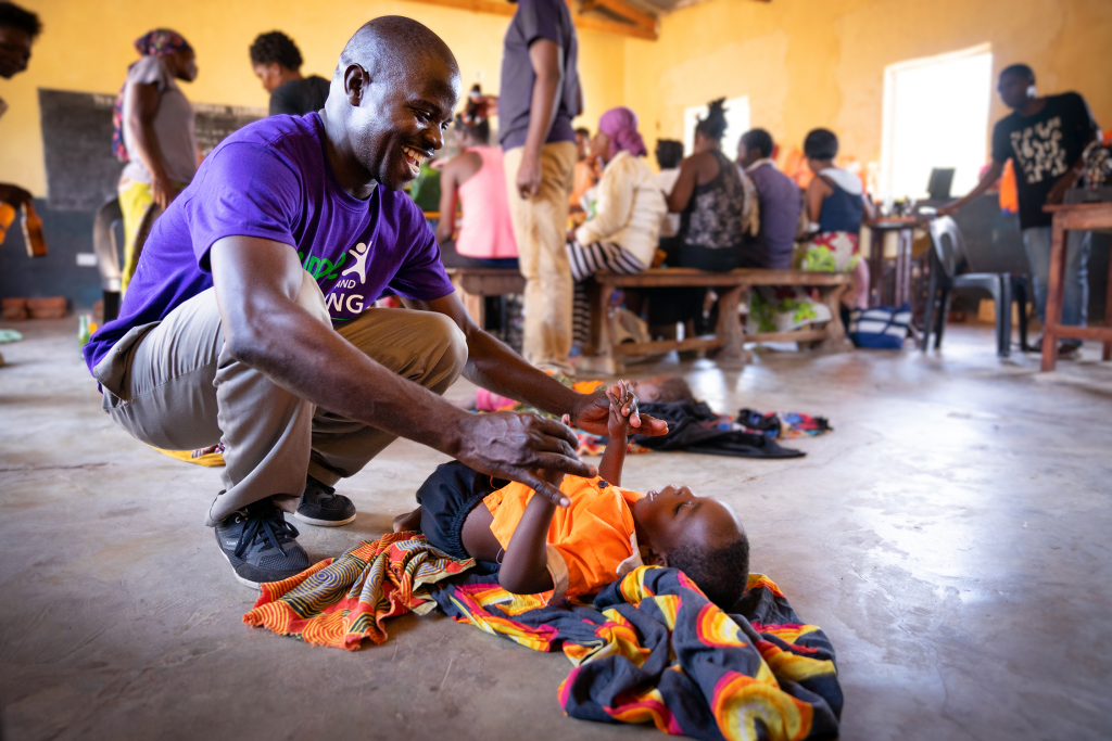 A trained health worker providing rehabilitation services for children with disabilities