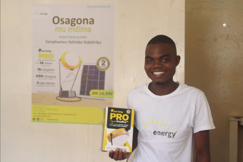 One of our staff showcasing our main product, the Sun King Pro Pay-As-You-Go Lantern